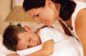 Mother with sleeping son stock photo