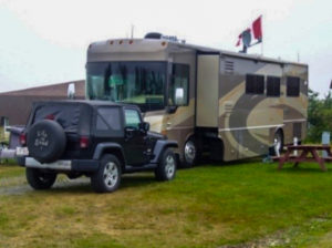 Motorhome with Jeep in Campground