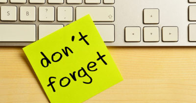 Don't Forget post it note on keyboard