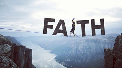 Woman on a tight rope with a faith sign