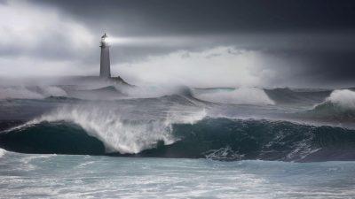 Lighthouse with waves crashing below
