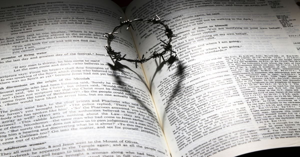 Crown of Thrones with heart shadow on open bible