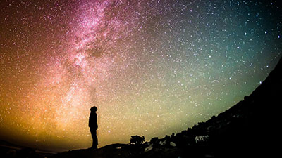 silhouette of person looking at stars